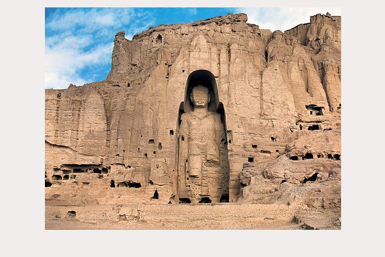 Colossal Buddha at Bamiyan in present-day Afghanistan (West Buddha surrounded by caves, c. 6th-7th c C.E., stone, stucco, paint, 175 feet high, Bamiyan, Afghanistan, destroyed 2001)
